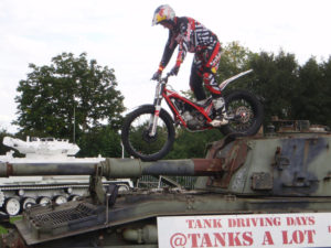 Dougie Lampkin Rides his bike over our tanks